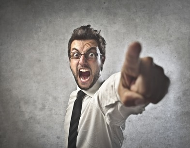 Businessman Yelling and Pointing - Workplace bullying