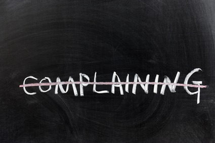 "Word ""Complaining"" On a Chalkboard Crossed out"