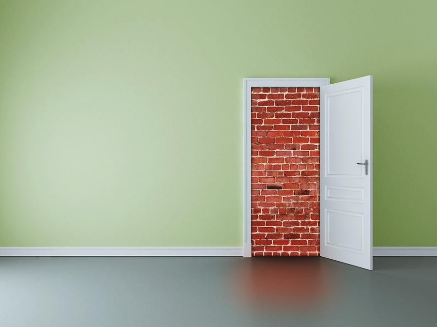 Door Open To Show a Brick Wall