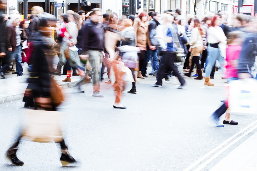 Blurry Photo of People On a Busy Street