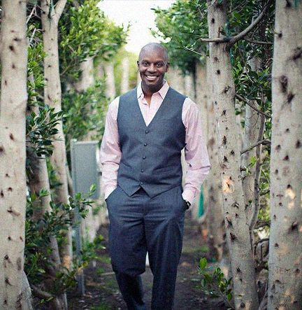 Richard Shola With Hands In Pockets Walking On A Path Through Trees