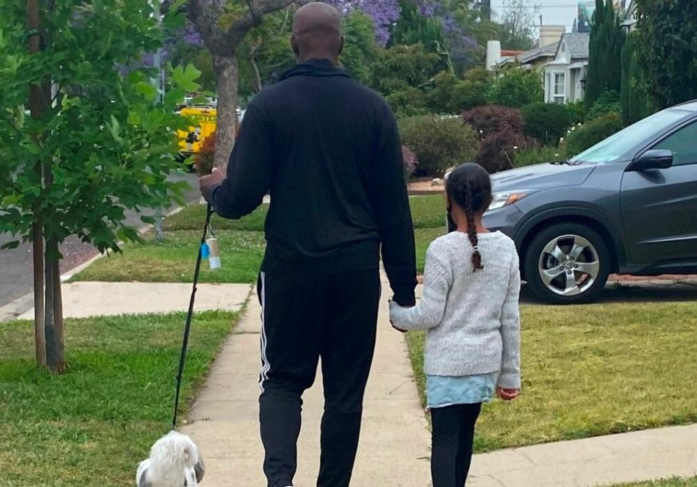 Shola Richards Walking His Dog With His Daughter